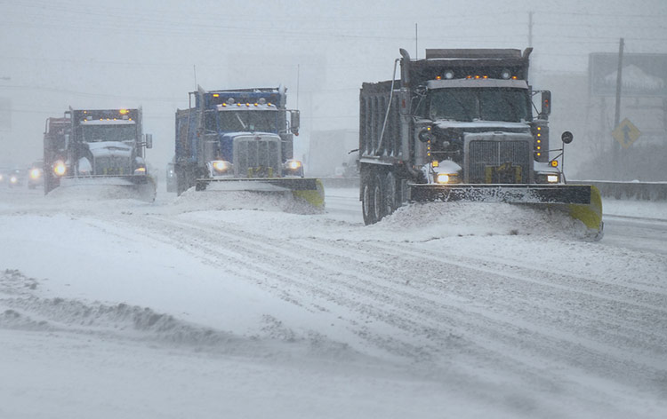 Snow Plows Clearing Road